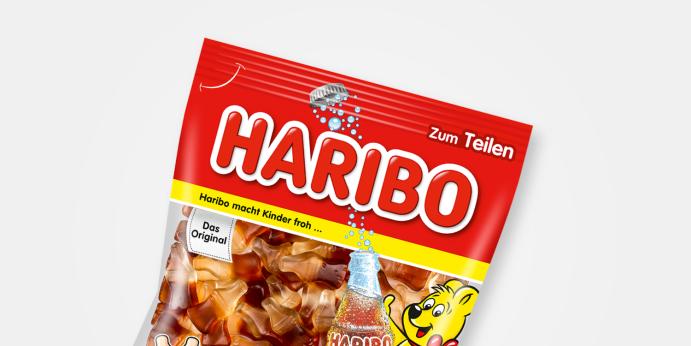 Produktabbildung Happy Cola im Anschnitt auf hellem Hintergrund