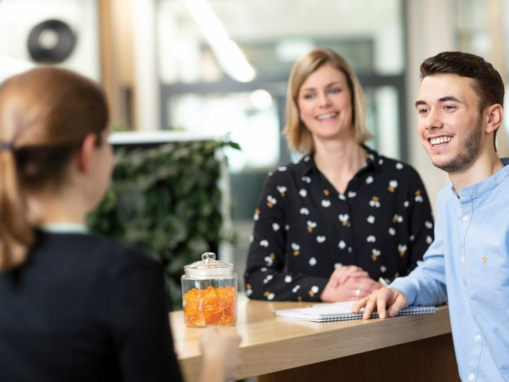 Young employees in conversation with their supervisor at HARIBO