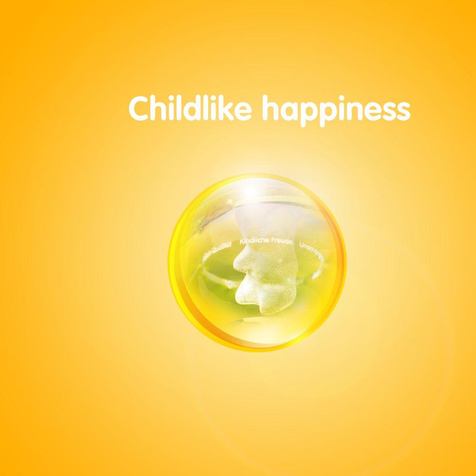 Изображение золотого мишки в прозрачном шаре на желтом фоне с текстом «Детская радость»