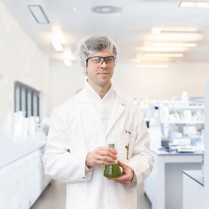 An employee checking the sample from a delivery of raw materials