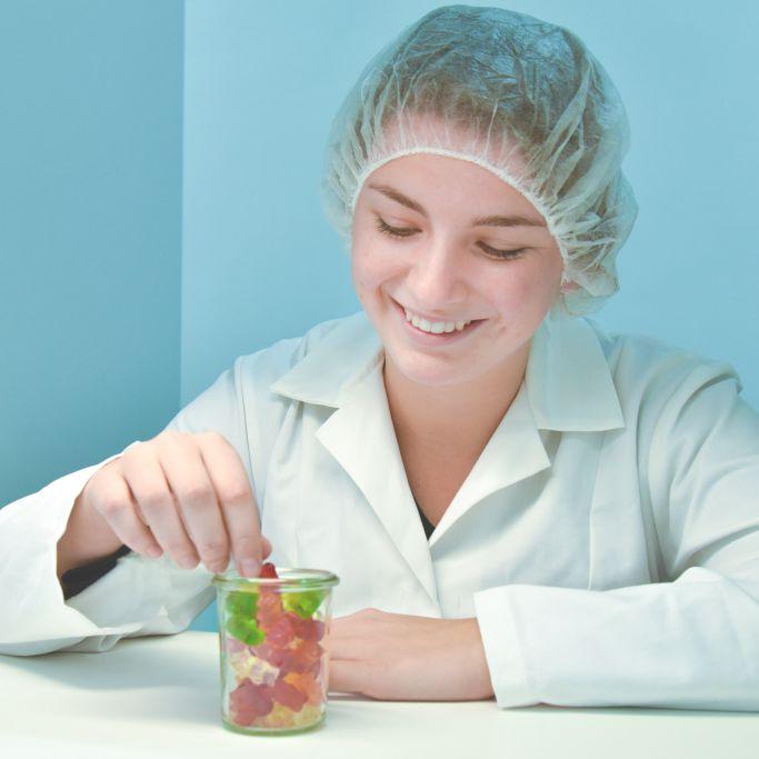 Employee testing HARIBO products