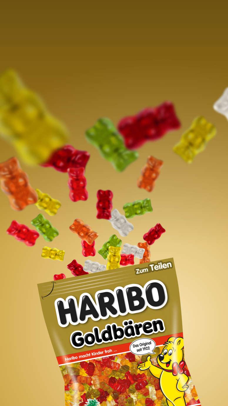 Gummibärchen fliegen aus HARIBO Goldbären-Beutel