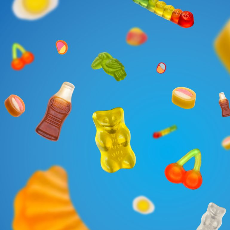 Colorful HARIBO product pieces flying around