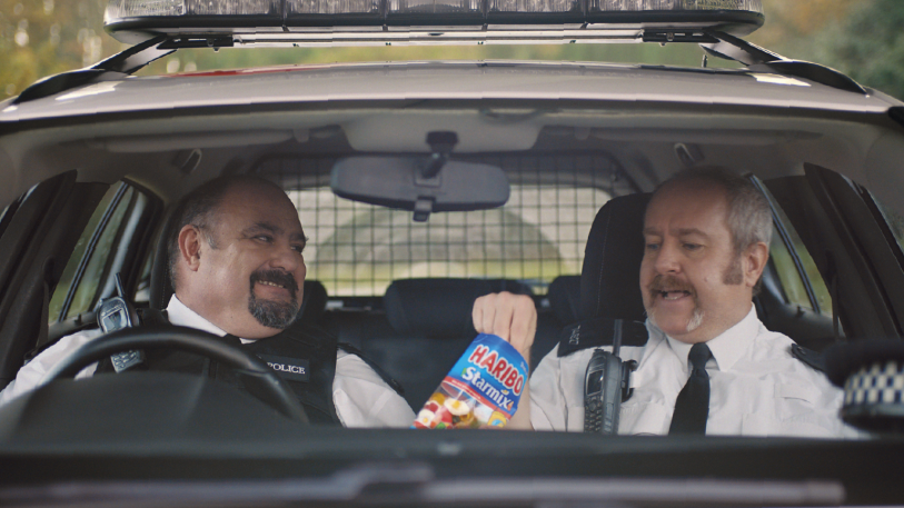 Preview image for tv ad two police officer enjoying HARIBO Starmix