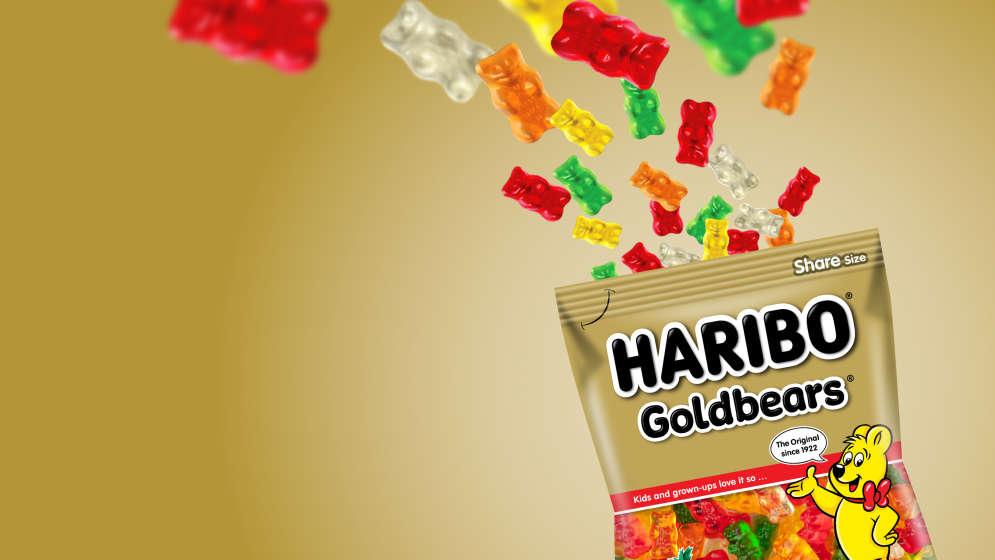 Bag of HARIBO Goldbears and fruit gums on golden background