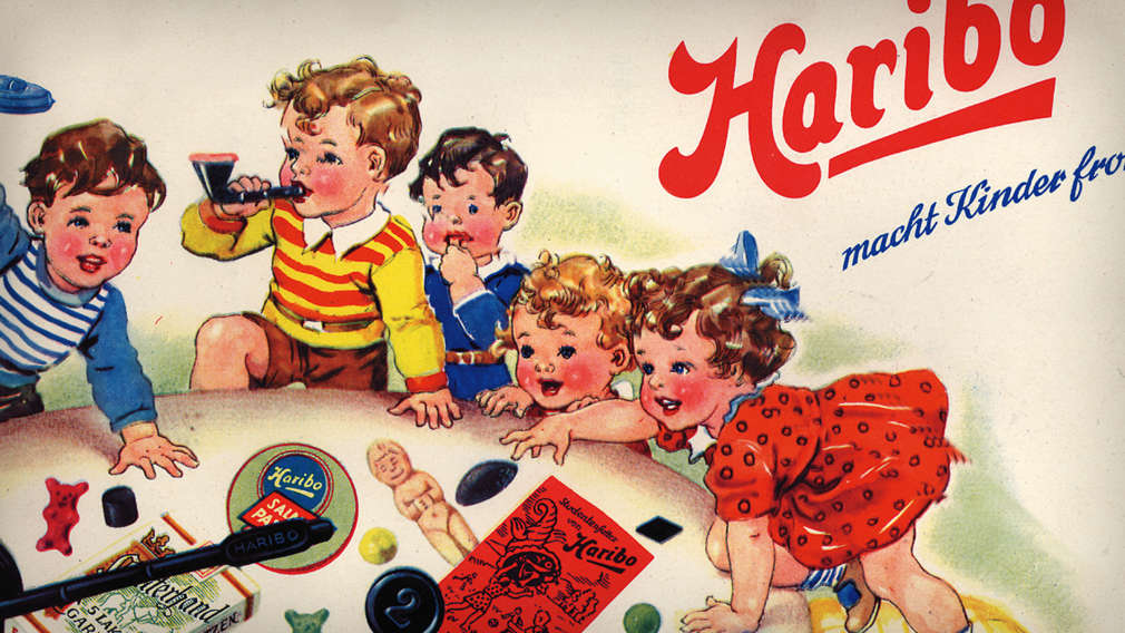 Anúncio antigo da HARIBO, crianças a brincar com ursinhos de goma e alcaçuz