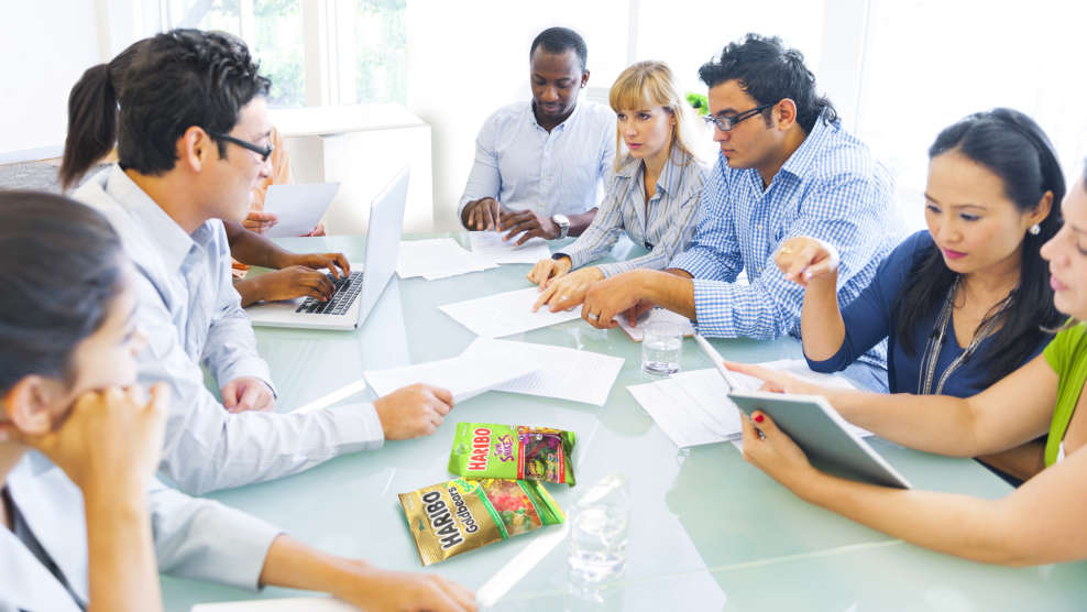 diverse team of employees discussing at a table